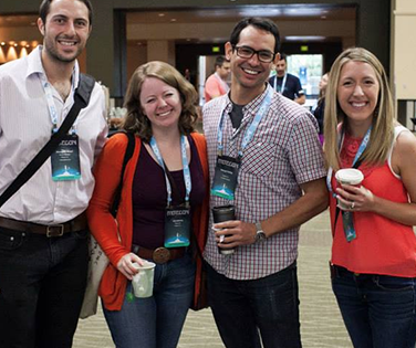 Portent employees at an industry conference for Portent jobs