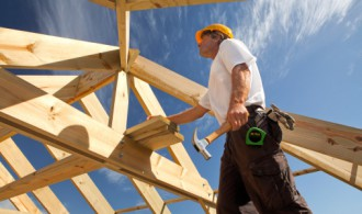 Man Working on a Building Structure