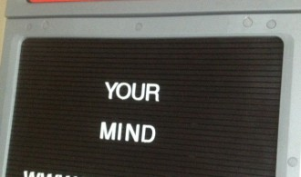 """Open your Mind written on a classic """"Open"""" restaurant sign"""