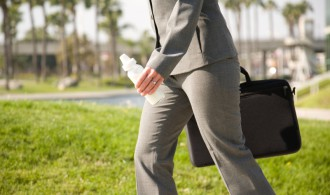 Mom walking to work with briefcase and milk bottle