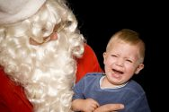 santa with crying child