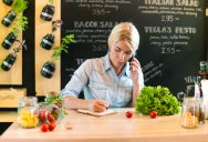 Woman on phone at her small business
