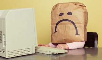 sad sack at a computer