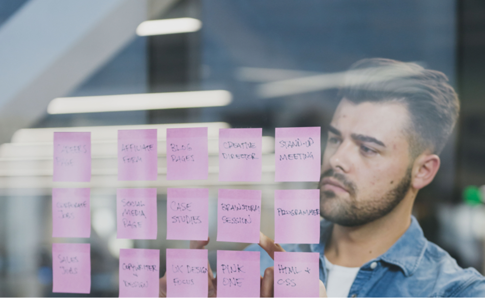 Content Strategy and planning with post-it notes on a glass window