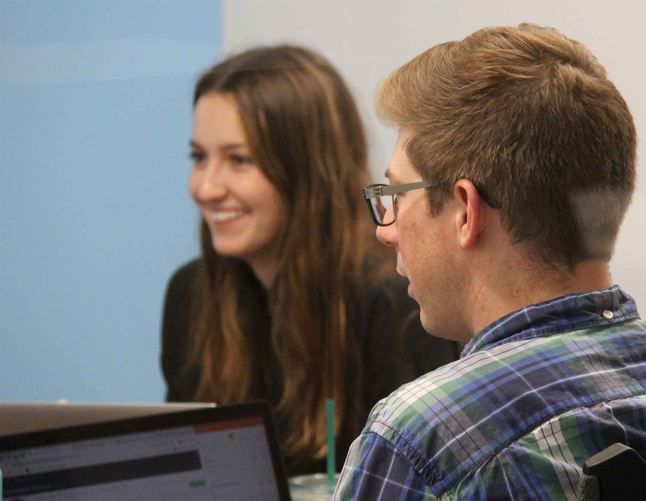Zac Heinrichs and Kat Shereko working at Portent a digital marketing agency in Seattle