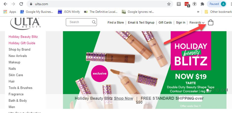 Screenshot of Ulta.com homepage with red arrow pointing to the checkout bag image in the top right of the navigation