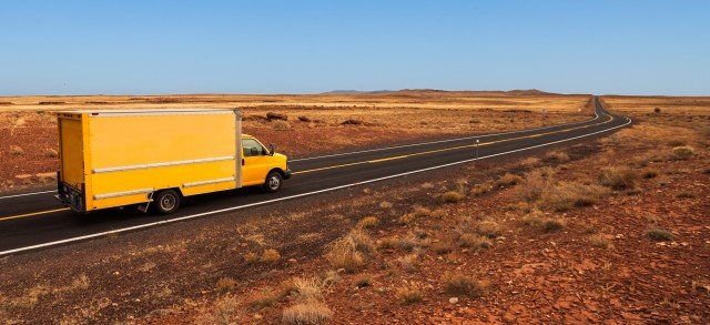 Yellow moving truck in the desert